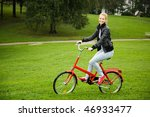 woman driving a bike in the park   Shutterstock . vector #46933477