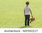 sad young boy is holding a... | Shutterstock . vector #469342217