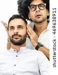 Small photo of businessman and popular hairdresser beautify the hair in the private area