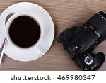 cup of black coffee and camera... | Shutterstock . vector #469980347