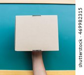 hand holding a box   Shutterstock . vector #469982315