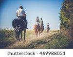 Stock photo group of horseback riders 469988021