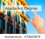 Small photo of Academic Degree - Hand pressing a button on blurred background concept . Business, technology, internet concept. Stock Photo