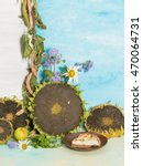 Small photo of colorful autumn still life with sunflowers and ripe bright garden flowers and daisies ageratum and delicious freshly baked pastries on a background of blue and white painted wall