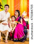 happy indian family celebrating ... | Shutterstock . vector #470384705