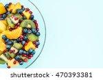 fruit salad in glass bowl ... | Shutterstock . vector #470393381