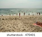 Here's a shot of some people enjoying a nice day at the beach. - stock photo