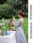 bride in long dress looking in... | Shutterstock . vector #470435681