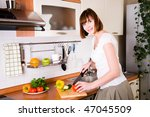 home life: woman preparing something to eat - stock photo