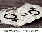 a female symbol  an equals sign