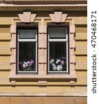 Two Old Beautiful Windows On A...