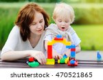 young woman with her toddler... | Shutterstock . vector #470521865