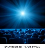 viewers watch film at movie...