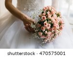 gracious bride holds beautiful... | Shutterstock . vector #470575001