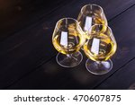 Three Snifter Glasses With...