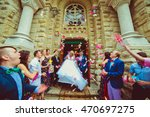 guests throw pink petals over... | Shutterstock . vector #470697275