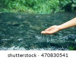 woman pouring water in hand | Shutterstock . vector #470830541