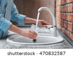 Female Hands Pouring Water In...