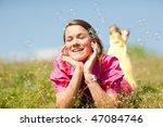 pretty smiling girl relaxing on ... | Shutterstock . vector #47084746