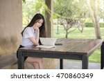 student reading a book at... | Shutterstock . vector #470860349