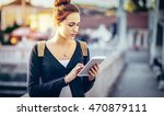 young woman using tablet | Shutterstock . vector #470879111