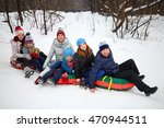 Six People On Snow Tubes Down...