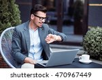 positive man sitting in the cafe | Shutterstock . vector #470967449