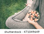 young girl eating a oatmeal... | Shutterstock . vector #471049649