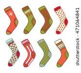 set of christmas socks on a... | Shutterstock .eps vector #471064841
