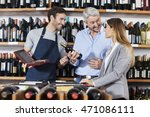 man holding wine bottle while... | Shutterstock . vector #471086111