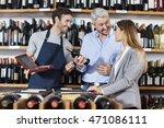 man holding wine bottle while... | Shutterstock . vector #471086111