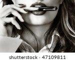 Sexy woman and a fountain pen - stock photo