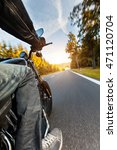 Small photo of Motorcycle driver riding on motorway in beautiful sunset light. Shot from pillion driver view