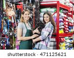 Stock photo happy woman buying french bulldog from saleswoman in store 471125621