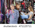 Stock photo couple buying pet equipment at store 471125711
