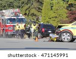 Small photo of ABBOTSFORD - AUGUST 19, 2016: A collision at the intersection of George Ferguson and Trethewey is cleaned up by Fire Services using absorbent material on August 19, 2016 in Abbotsford, BC, Canada.
