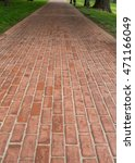 Long Red Brick Pathway Through...