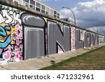 Berlin Wall With Graffiti Of...