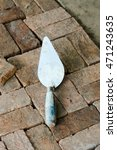 Small photo of Plaster, plastering trowel