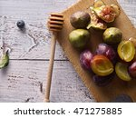 ripe figs  plums and honey on... | Shutterstock . vector #471275885
