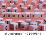Small photo of ADMIRABLE word on wooden cube isolated on orange background