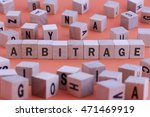 Small photo of ARBITRAGE word on wooden cube isolated on orange background