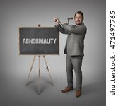Small photo of Abnormality text on blackboard with businessman