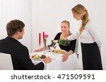 female waitress pouring...   Shutterstock . vector #471509591