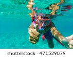 funny child diver in sea with... | Shutterstock . vector #471529079