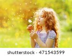 little curly girl blowing... | Shutterstock . vector #471543599