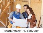 Worker Shows House Design Plan...