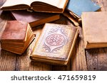 old books on a wooden table | Shutterstock . vector #471659819
