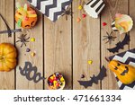 Stock photo halloween holiday background with pumpkin and candy view from above 471661334