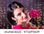 Beautiful Indian Woman Holding...